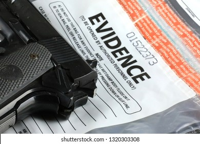Pistol and Evidence bag at a crime scene