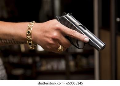 Pistol in hands. Hands with gun.