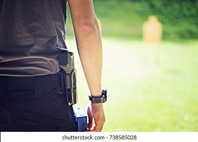 Pistol in the holster. Asian man get ready takes out a pistol from the holster.