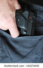 Pistol in jeans pocket