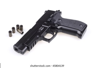 Pistol on the raked target. Isolated object