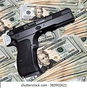 Pistol on a stack of twenty dollar bills