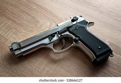Pistol on wooden board.