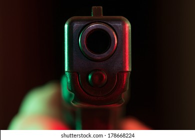 Pistol pointed at point blank range