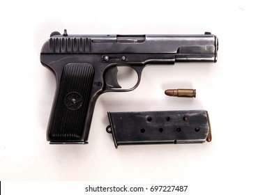 Pistol of TT brand, cartridges and clip in white background