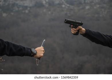 Pistol versus knife fight