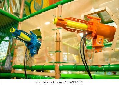 Pistols guns blasters in children play and entertainment center. Children's toy guns on the playground