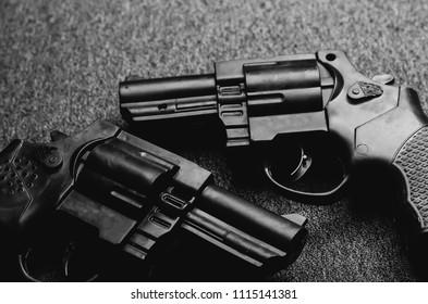pistols on a dark background