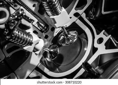 A piston engine in cross section. Close-up. Black and white.