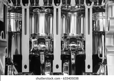 Pistons of a car engine. Close up of an industrial product. A black and white image of machine parts.