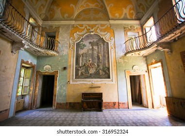 PISTOYA, ITALY-JUN 12,2014:Abandoned Sbertoli villa. Old house on hill with views of the vineyards and sunny edge of Tuscany. The main hall,decorated frescoes on side walls and ceiling.