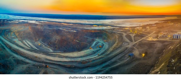 Pit gold mining in Russia, Siberia, a landscape at sunset, shooting from air