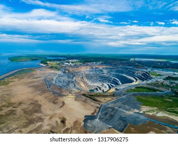 Pit on open-pit mining of minerals in Russia, Siberia, shooting from air