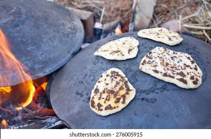 Pita bread baking on a Saj or Tava on Lag Baomer