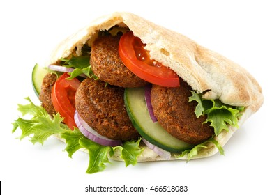 Pita bread filled with falafel and salad isolated on white.