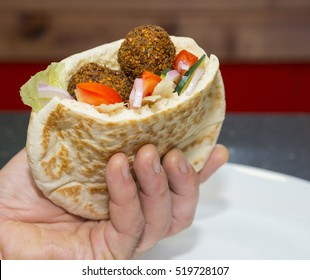 Pita bread filled with falafel and vegetable salad