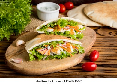 Pita with chicken, vegetables and sauce, delicious lunch, fast food, stuffed roll