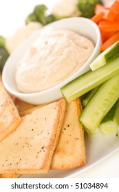 Pita chips and fresh vegetable make a healthy appetizer or snack along with hummus