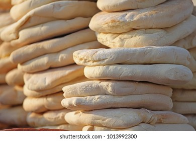 Pita. Pile of roasted pita, baked flat bread. Heap of focaccia. Lavash. Purlenka. Bread background. Flat bread background texture. Pile of fresh roasted bread.