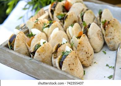 pita sabich sandwich - pita stuffed with fried eggplant and hard boiled eggs Iraqi Jews