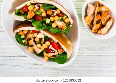 Pita Sandwiches with Grilled Chicken and Chickpea or Garbanzo Beans Salad. Selective focus.