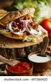 Pita shawarma. Gyros. Tomato, lettuce, meat, onion, special dressing, chilly sauce