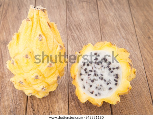 Pitahaya on the wooden table (Selenicereus megalanthus)