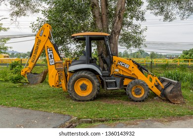 Pitas, Sabah, Malaysia - October 16 2016: JCB Caterpillar 3CXeco, owned by the District Council and operated by the Public Works Department