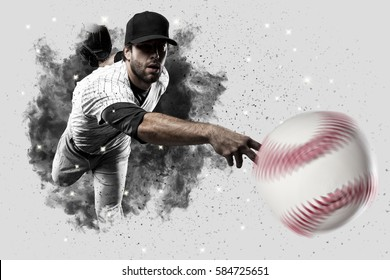 Pitcher Baseball Player with a white uniform coming out of a blast of smoke .