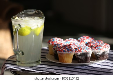 A pitcher of fresh lemonade and a plate of cupcakes.  Perfect!