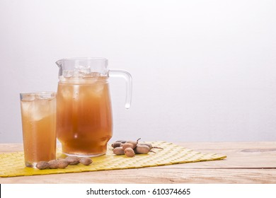 Pitcher and glass of cold tamarind drink.