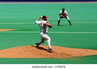 Pitcher, left-handed, Pitcher in full-wind-up