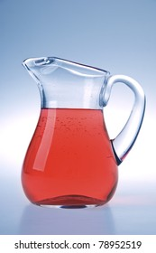 Pitcher with lemonade in blue light
