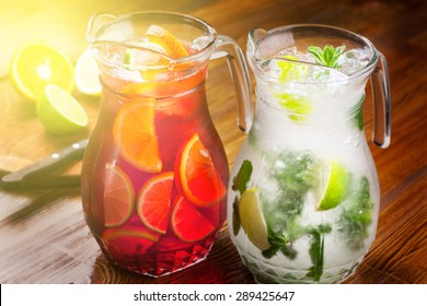 pitcher refreshing refreshing drink. a large portion of mojito and sangria. toned photo