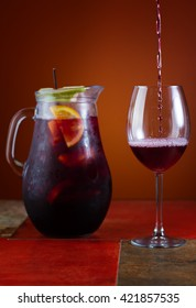 Pitcher of sangria. Sangria being poured into the glass