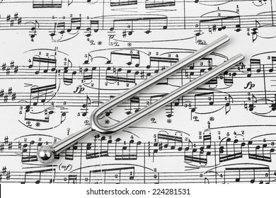 Pitchfork on sheet music - abstract art background