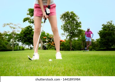 Pitching being hit or chip to a golf ball by woman golfer, to reach the final best score winning, chip golf ball from rough of fairway to the hole on the green