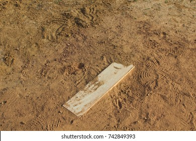 The pitching mound rubber on a close up view.