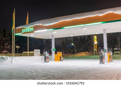 Pitea, Sweden - February 2021: Preem brand gasoline station during Winter with lots of Snow after heavy snowfall in Pitea city in Sweden.