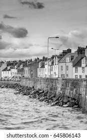 PITENWEEM, SCOTLAND - 26, SEP 2011:  Waves lap at the coastal wall in this small Scottish fishing village