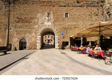 Pitigliano, Italy, -  September 17, 2017: Tourists in an outdoor bar in Pitigliano in Tuscany, Italy