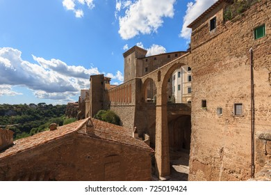 Pitigliano is a medieval town in Tuscany in Italy (in the foreground the aqueduct and in the background Palazzo Orsini).