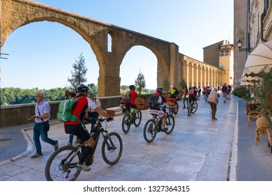 Pitigliano,Italy-april 29,2018:cyclists for the ancient streets of Pitigliano during a sunny day.