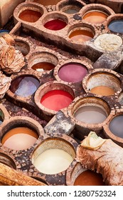 Pits of various colored dyes are used in the Chouara leather tannery in Fes, Morocco, to add color to the leather skins after they have been tanned.