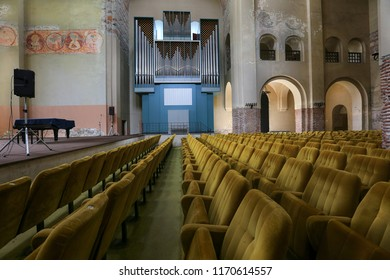Pitsunda, Abkhazia, on May 9, 2017. Rows of armchairs and organ for a concert at the Patriarchal Cathedral in Pitsunda