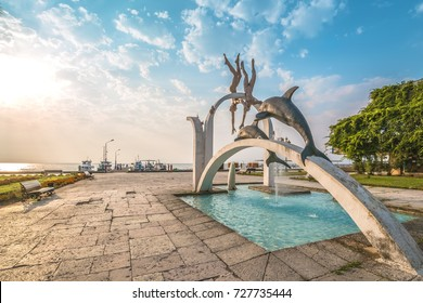 """PITSUNDA, ABKHAZIA, SEPTEMBER 23, 2017: Famous sculptural composition """"The Sea"""", which depicts pearl divers and dolphins, in the central part of Pitsunda, Abkhazia"""
