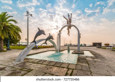 """PITSUNDA, ABKHAZIA, SEPTEMBER 23, 2017: Famous sculptural composition """"The Sea"""" in the center part of Pitsunda early morning. Author of the sculpture is the Georgian sculptor Irakli Ochiauri."""