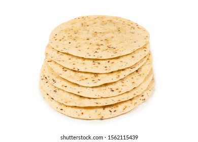 Pitta bread with seeds isolated on white