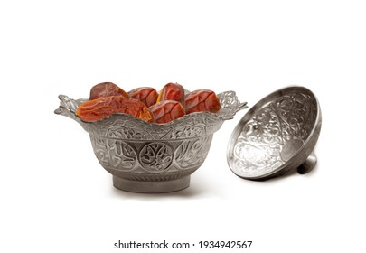 Pitted dates. Traditional iftar food. metal bowl full of date fruits on isolated white background. Symbolizing Ramadan
