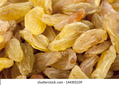 Pitted dried grapes (raisins) brightly lit close up